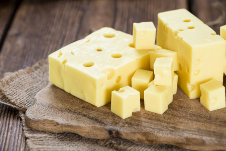 grated cheese: Portion of Cheese (close-up shot) on rustic wooden background Stock Photo