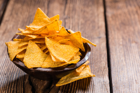 portion: Portion of Nachos on rustic wooden background