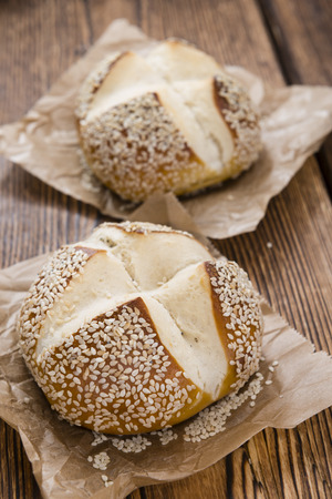 sesame seeds: Pretzel Roll with Sesame seeds on rustic wooden background