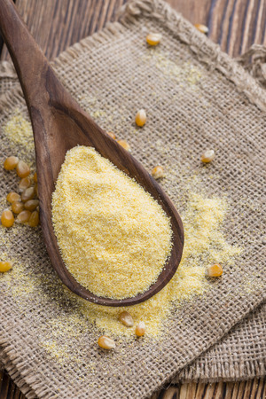 mais: Heap of fresh Cornmeal as detailed close-up shot Stock Photo