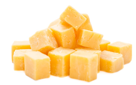 Diced Cheddar isolated on pure white background (close-up shot)