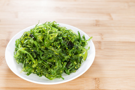wrack: Fresh made Kelp Salad (close-up shot) on wooden background Stock Photo