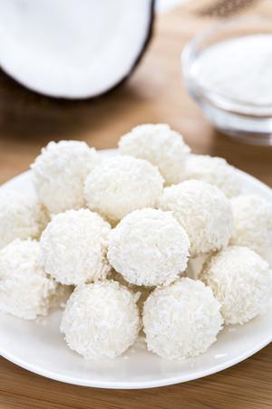 a portion: Portion of Coconut Pralines (detailed close-up shot)