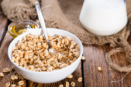 puffed: Puffed wheat breakfast cereals with honey and milk