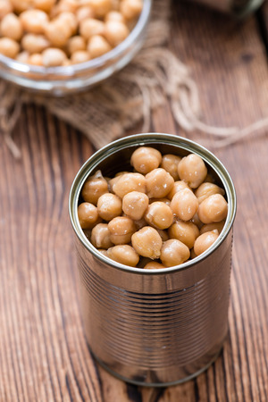 canned peas: Portion of Chick Peas (Canned) on old wooden background