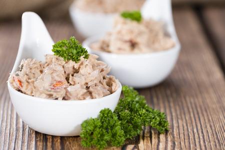 tuna salad: Bowl with Tuna salad on dark rustic wooden background