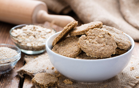 oatmeal cookie: Some Oat Cookies on rustic wooden background (close-up shot)