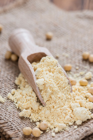 soja: Heap of Soy Flour (close-up shot) on rustic wooden table