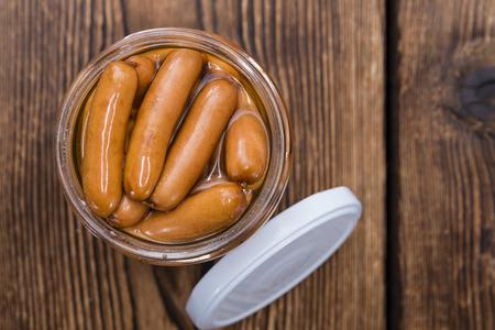 portion: Portion of Mini Sausages (detailed close-up shot)