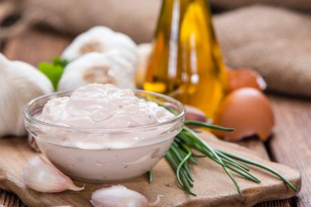Fresh made Aioli (Garlic dip) on wooden background