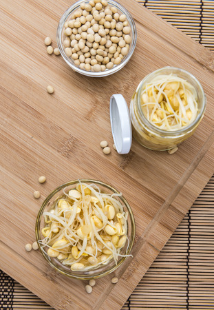 soy sprouts: Portion of preserved Soy Sprouts (on wooden background) Stock Photo