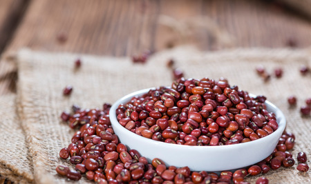 rote: Dried red beans on dark rustic wooden background
