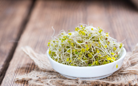 broccoli sprouts: Fresh Broccoli Sprouts (detailed close-up shot) on vintage wooden background Stock Photo