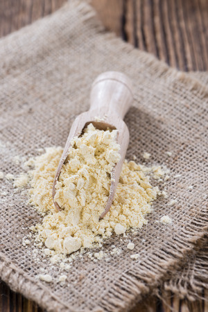 chick pea: Portion of Chick Pea flour on vintage wooden background Stock Photo