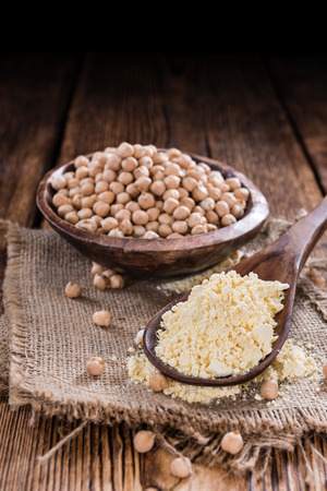 chick pea: Chick Pea flour (close-up shot) on vintage wooden background