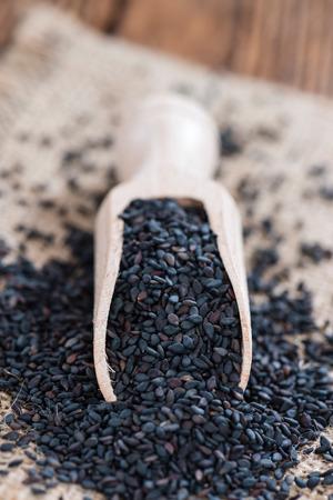 black sesame: Black Sesame (close-up shot) on rustic wooden background