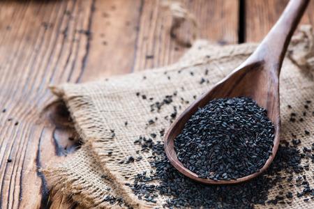black sesame: Heap of black Sesame (close-up shot) on wooden background