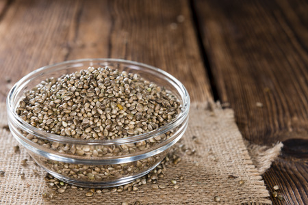 hemp hemp seed: Some Hemp Seeds (close-up shot) on wooden background Stock Photo