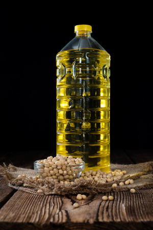 soja: Portion of Soy Oil (close-up shot) on an old wooden table Stock Photo