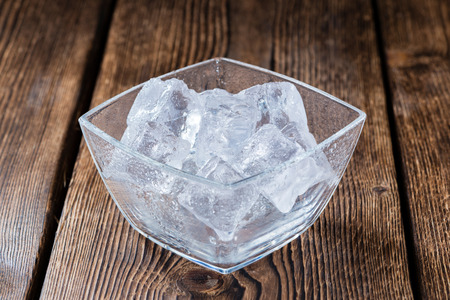 eis: Bowl with Ice Cubes (on dark wooden background) Stock Photo