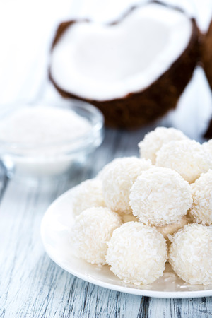 portion: Portion of Coconut Pralines on wooden background