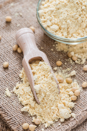 soja: Portion of Soy Flour on dark rustic wooden background Stock Photo