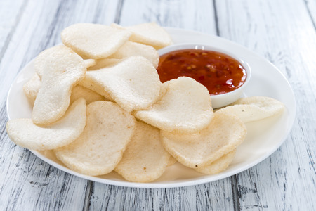 keropok: Fresh Krupuk (Prawn Crackers) on vintage wooden background Stock Photo