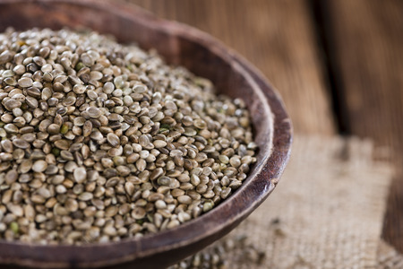 hemp hemp seed: Hemp Seeds (close-up shot) on an old wooden table Stock Photo