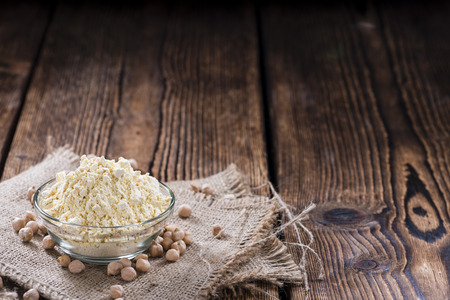 chick pea: Heap of Chick Pea flour on an old wooden table Stock Photo