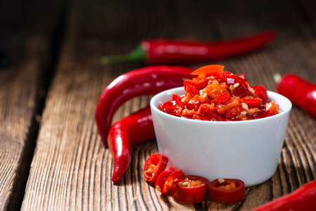 red chili pepper: Homemade Chili Dip (preserved with olive oil) on wooden background