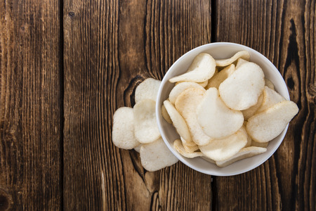 Fresh Krupuk (Prawn Crackers) on vintage wooden background Stock Photo