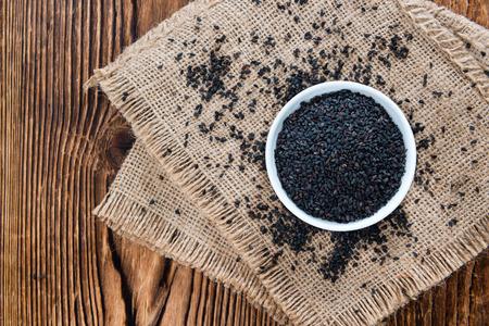 Small portion of black Sesame (close-up shot) on wooden background Stok Fotoğraf