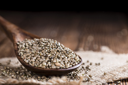 Hemp Seeds (close-up shot) on an old wooden table Banco de Imagens