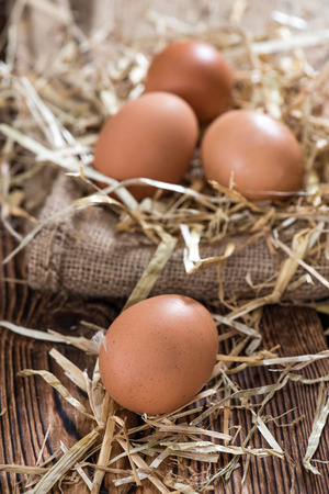 ei: Some fresh Eggs (close-up shot) on dark wooden background