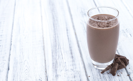 Chocolate Milk (close-up shot on bright wooden background)