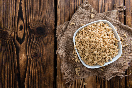 meat alternatives: Portion of Soy Meat close-up shot (on wooden background)