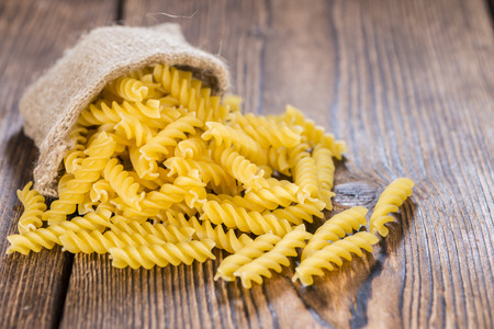 fussili: Portion of uncooked Pasta (Fussili, close-up shot) Stock Photo