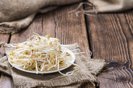 mung bean sprout: Mungbean Sprouts (close-up shot) on wooden background Stock Photo