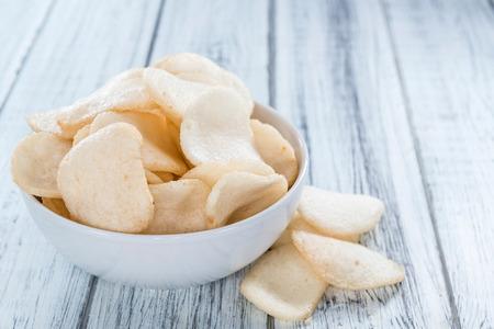 Fresh made Prawn Crackers (Krupuk) on wooden background
