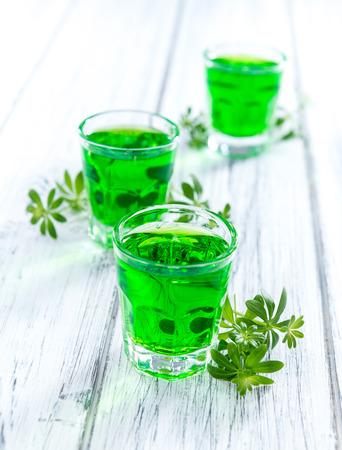 sweet woodruff: Sweet Woodruff Liqueur in a small glass (close-up shot)