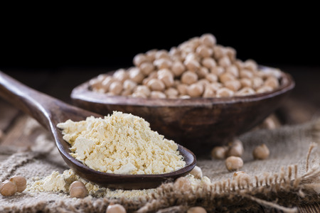 chick pea: Chick Pea Flour on dark rustic background (close-up shot)