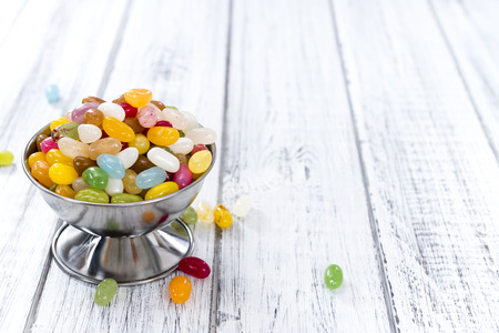 jelly beans: Heap of colorful Jelly Beans on bright wooden background