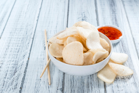 Fresh made Prawn Crackers (Krupuk) on wooden background