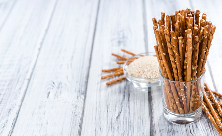 pretzel stick: Sesame Sticks (close-up shot) on wooden background