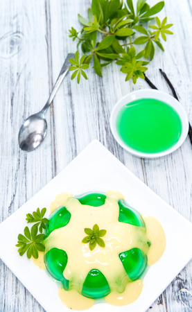 woodruff: Woodruff Jelly with Vanilla Sauce (on wooden background)