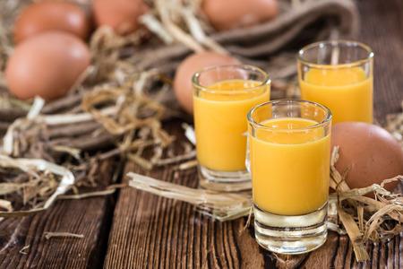 egg cup: Egg Liqueur (close-up shot) on wooden background