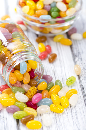 jelly beans: Heap of colorfull Jelly Beans (on bright wooden background)