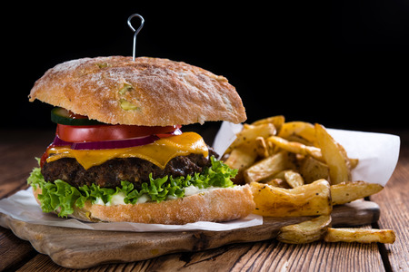 Homemade Ciabatta Beef Burger with cheese and homemade French Fries Stock Photo