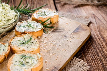 side order: Baguette (with Herb Butter and Garlic) on rustic wooden background