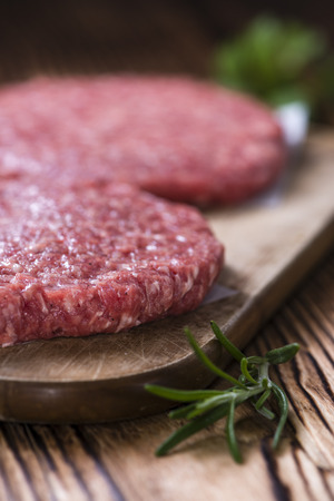 mincemeat: A raw Burger (minced Beef) on dark wooden background